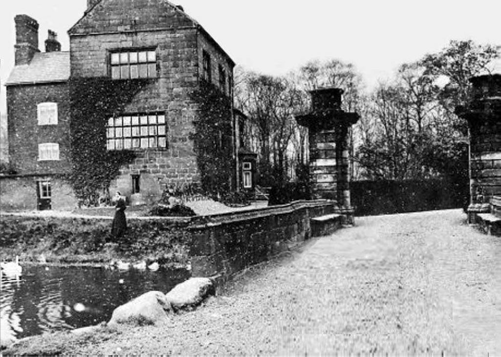 Bold Old Hall with bridge and twin gate piers and moat