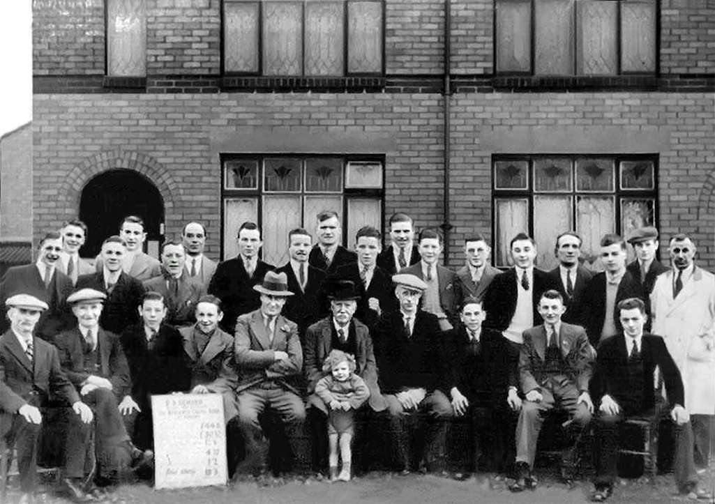 The Hewards and employees in front of two of the New Street houses that they built opposite Sutton Cricket Club