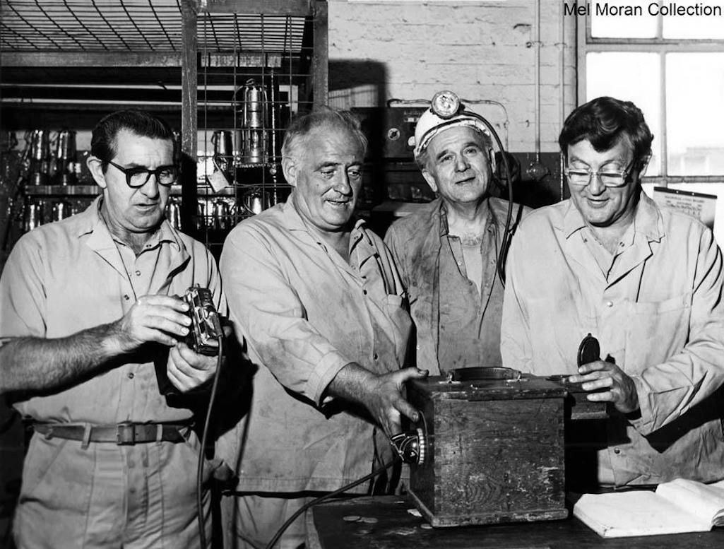 The Sutton Manor colliery lamp room team in 1981 examining lamps prior to their deployment down the pit
