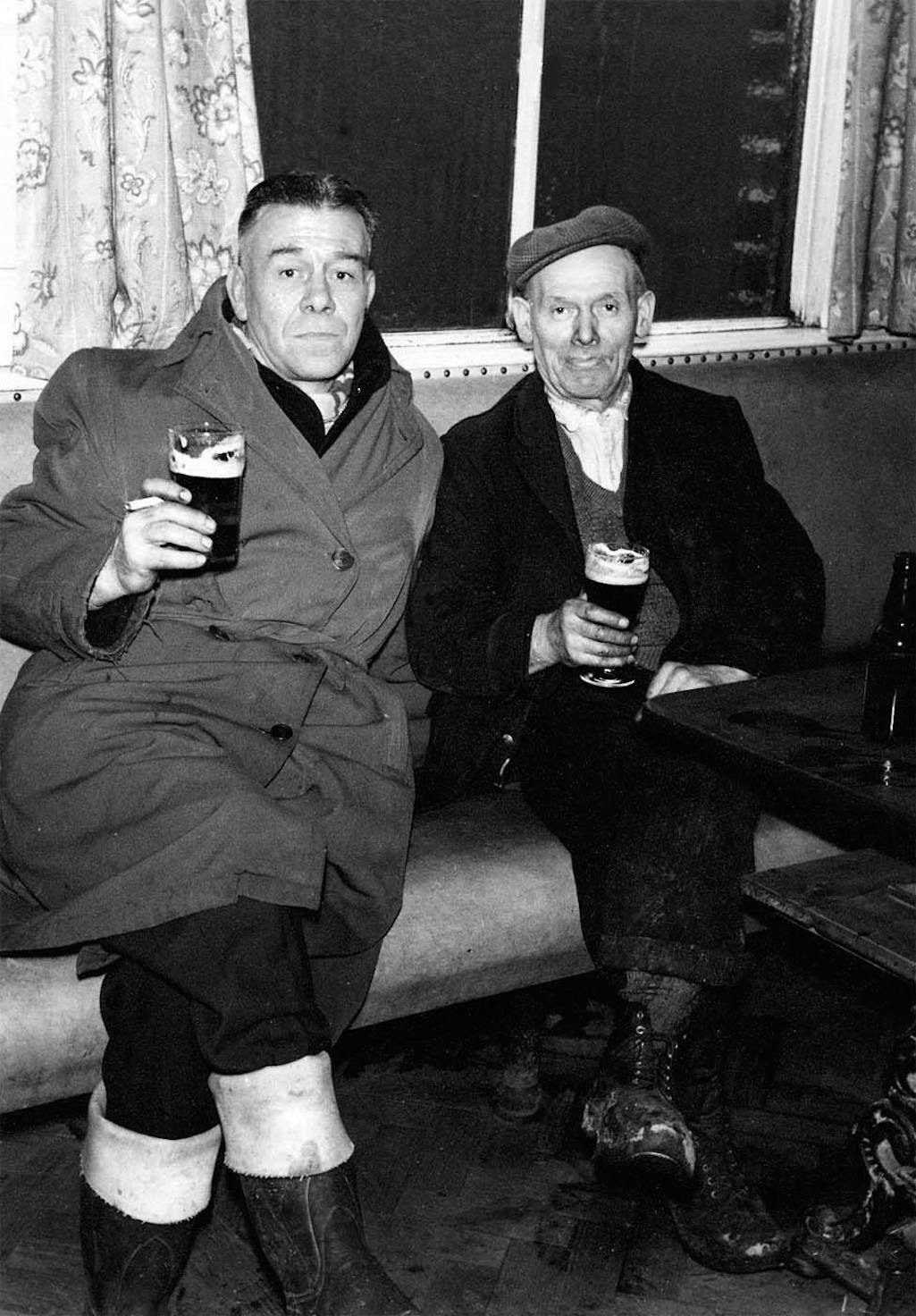 Tom Austin and James Bud Lamb enjoying a pint at the Bull & Dog, Sutton, St.Helens during the 1960s
